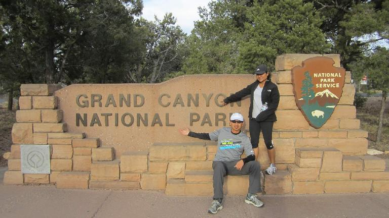 Bandy and Sara in front of the Grand Canyon National Park sign.