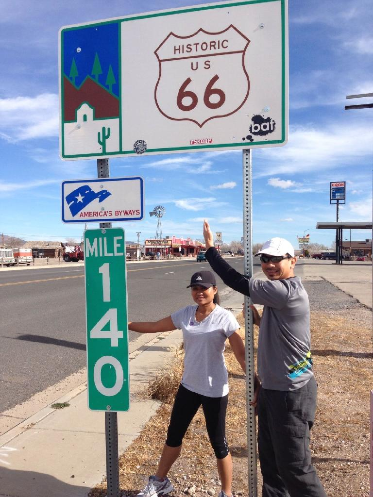Sara and Bandy by a sign for Historic Route 66.