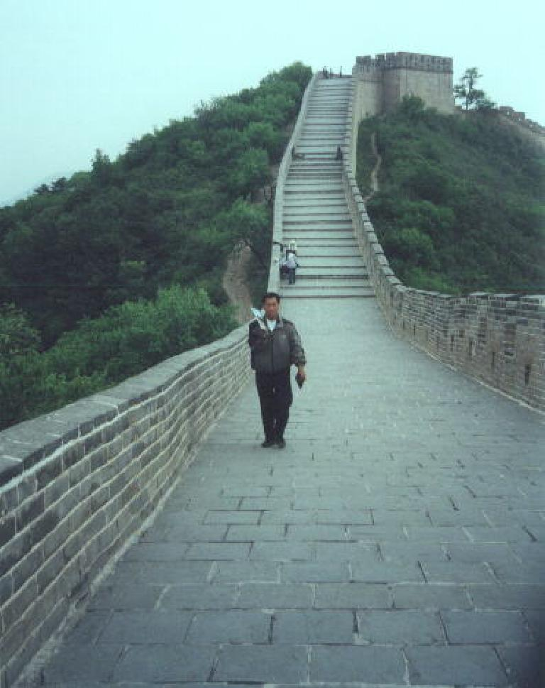 "On the ""left"" side of the Great Wall at Badaling, I was constantly chased by people selling memorabilia (like this dude with a book) despite me pretending to only speak Spanish.  Poor Felix!"