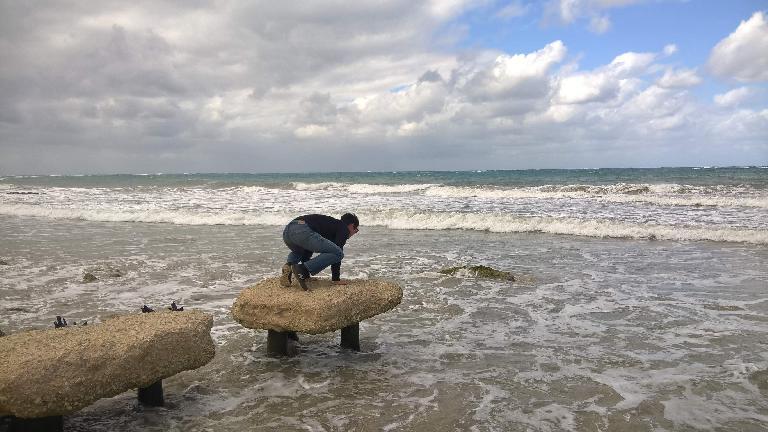 Felix Wong doing a yoga pose in Guanabo, Cuba.