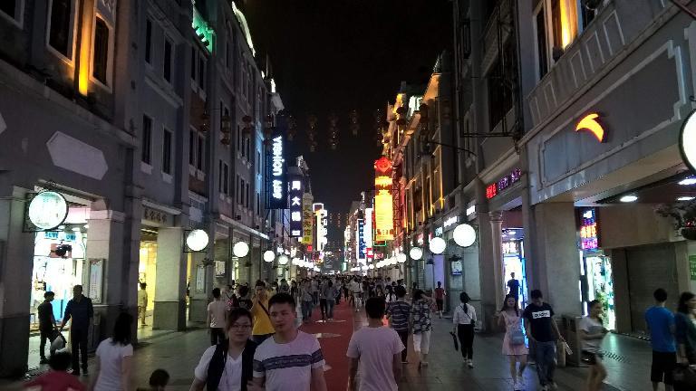 The half-mile Shangxiajiu Pedestrian Street at night in Guangzhou, China. (April 21, 2016)