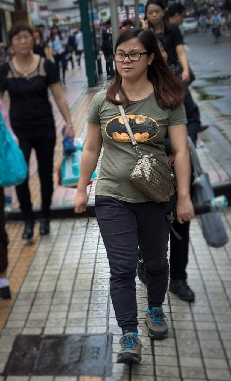A woman in Guangzhou, China, wearing a Batman shirt. (April 21, 2016)