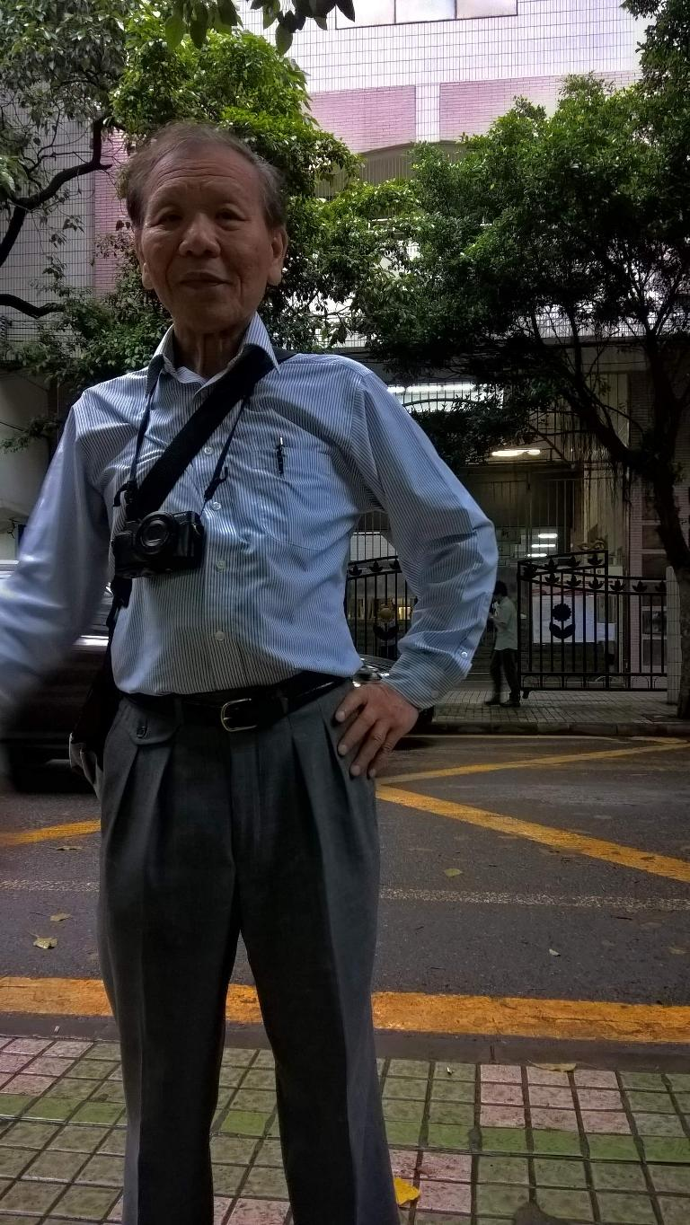 My dad in front of his old elementary school off Renmin N Rd. (near Jinghui Rd.) in Guangzhou, China. (April 22, 2016)
