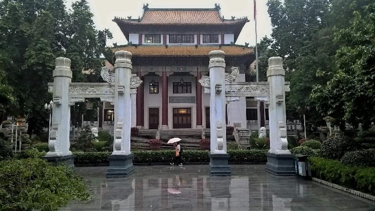 Woman walking with an umbrella outside Guangzhou's People Park (known as Central Park when my dad lived there) in Guangzhou, China.  (April 22, 2016)
