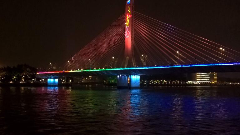 Lighted bridge on Inner Ring Rd. over the Zhujiang River as seen from a cruise ship. (April 22, 2016)