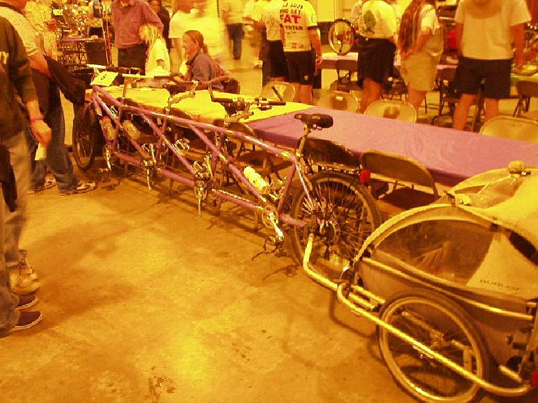 Here's a 4-person tandem with trailer in tow.  There was another 4-rider tandem at the show.
