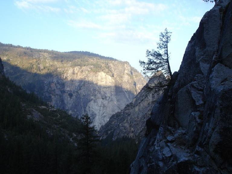 A rising sun lit up the granite faces around the Yosemite Valley as we hiked on in.