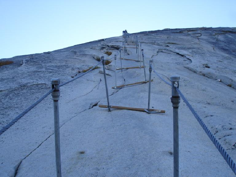 We descended Half Dome the hiker's way by means of these cables.  And after the 6 miles of hiking + 8 pitches (and 800 vertical feet) of rock climbing, we still had 9 -- no wait, 11 due to getting lost -- miles of hiking left to get back to the car, 3 miles of which were in darkness!