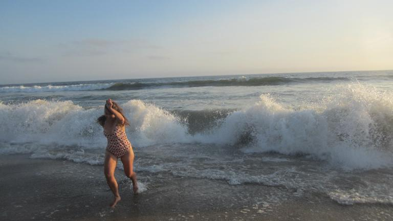 Katia getting out of the way of crashing waves.
