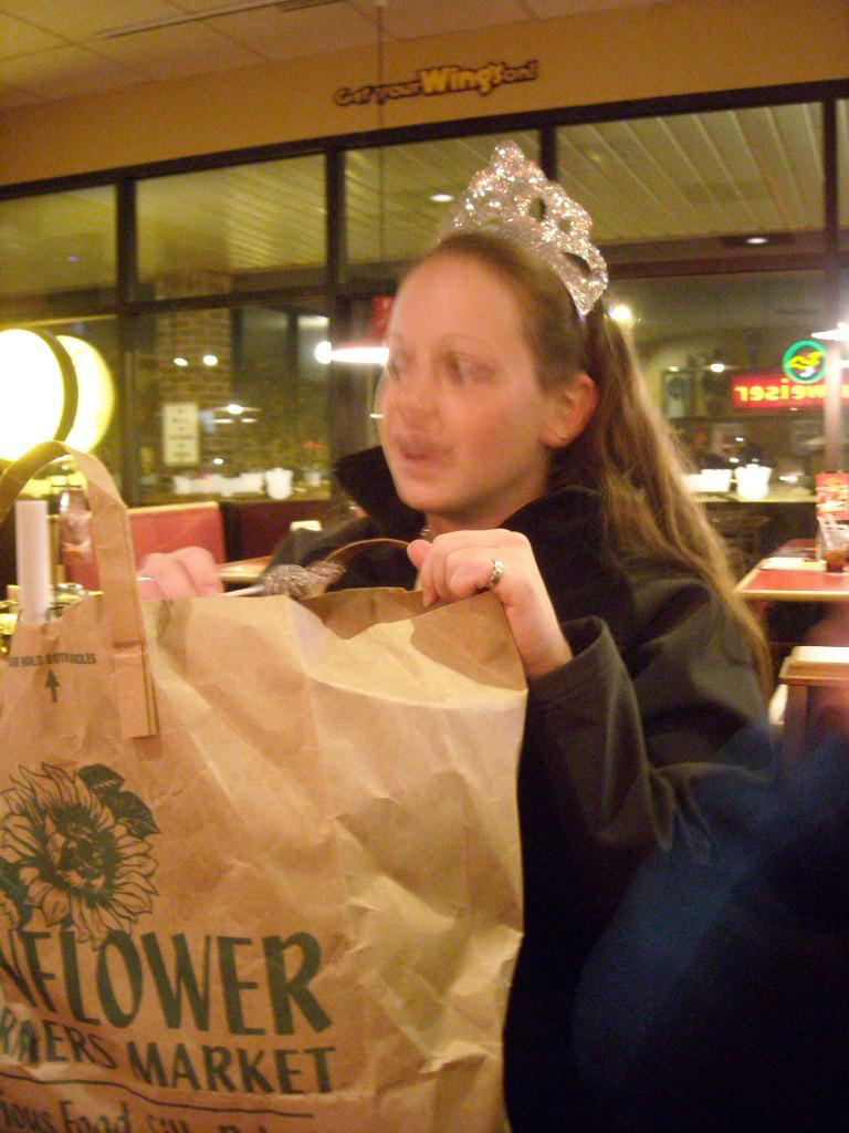 Queen Ryan looking inside a bag of sooo much candy.