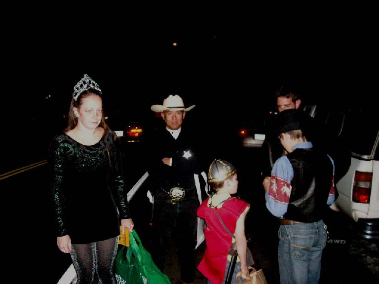 It was already dark when we met up to go trick-or-treating for books.  Here's Ryan, John, Davy, Cody, and Jon.