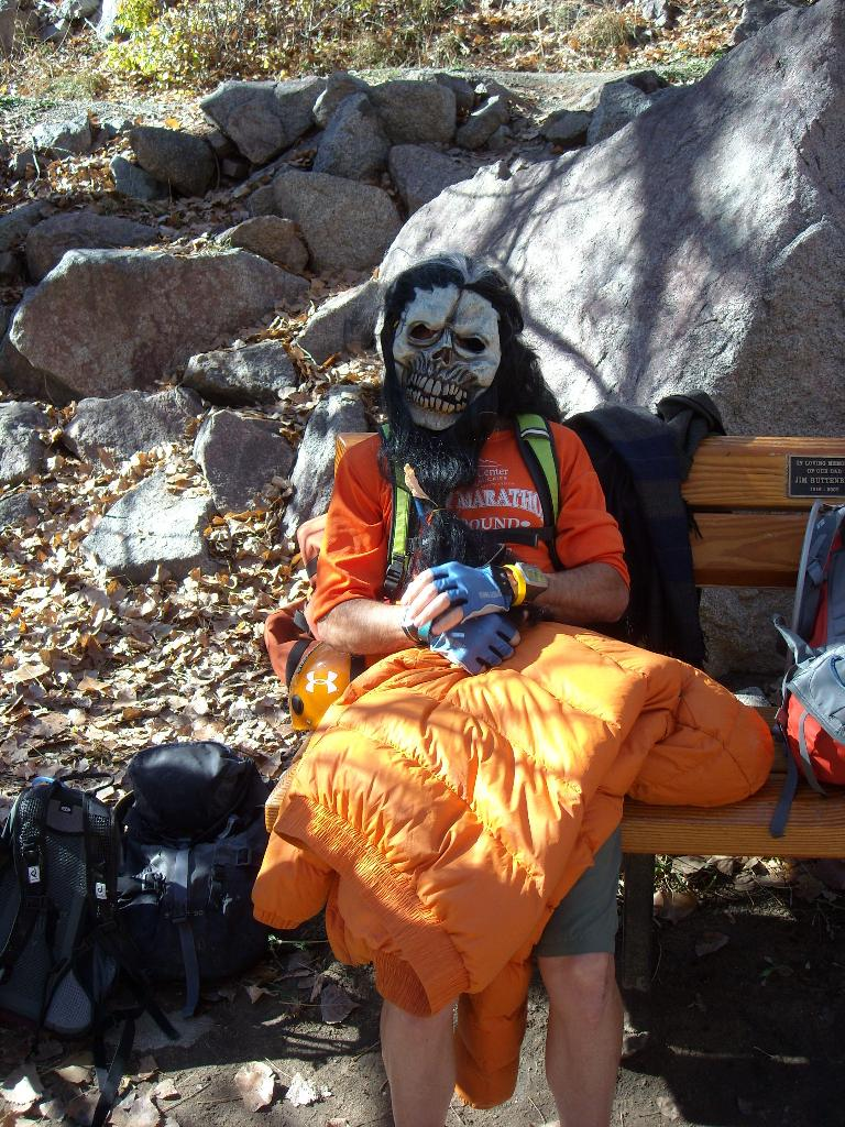 Eddie stays warm underneath a sleeping bag and gorilla mask.