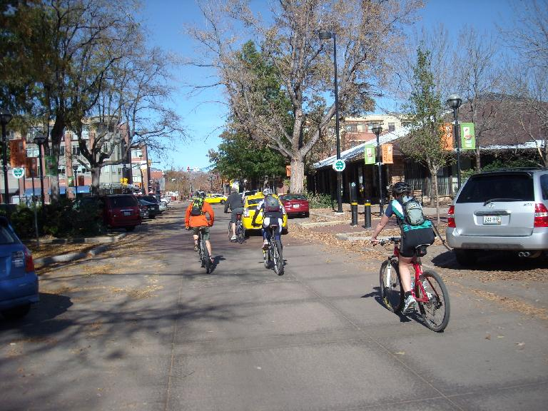 Biking towards the Pearl Street Mall.
