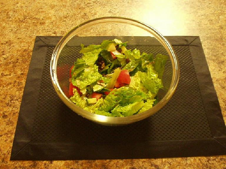 Green lettuce, black beans, tomatoes, and avocado.
