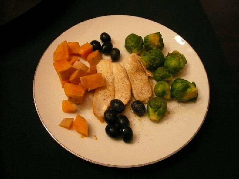Steamed butternut squash, brussel sprouts, olives, and chicken.  Colorful, quick, and delish!