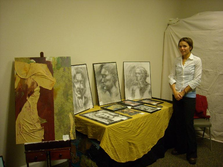 Leah with some of her artwork.