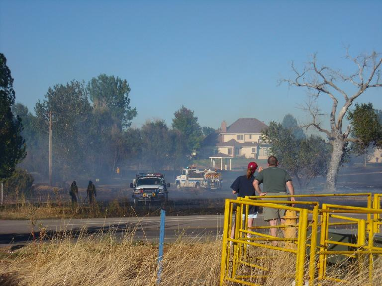 The fire threatened eight homes and caused relatively minor damage to one of them.
