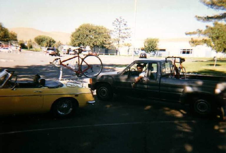 yellow 1969 MGB roadster, red Cannondale 3.0, luggage rack, bike rack, Ken Loo, Toyota truck