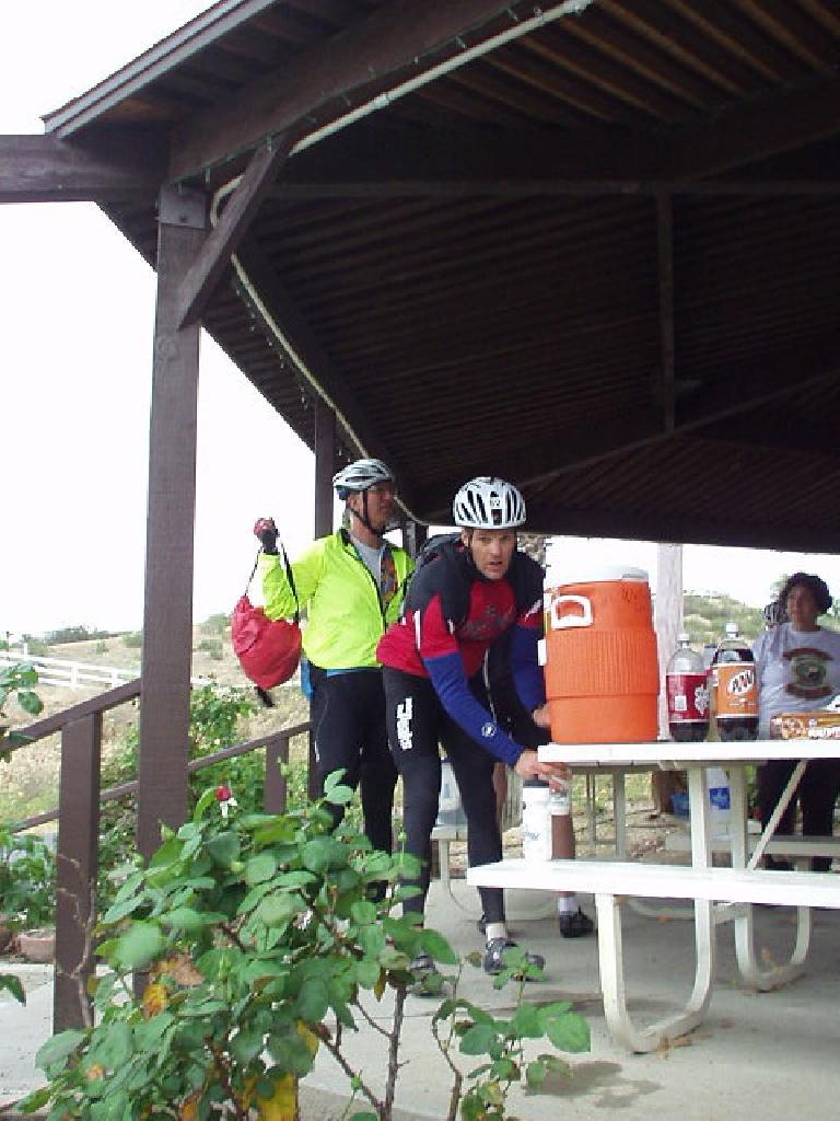 [Mile 150, 2:48] John replenishing his water bottles.