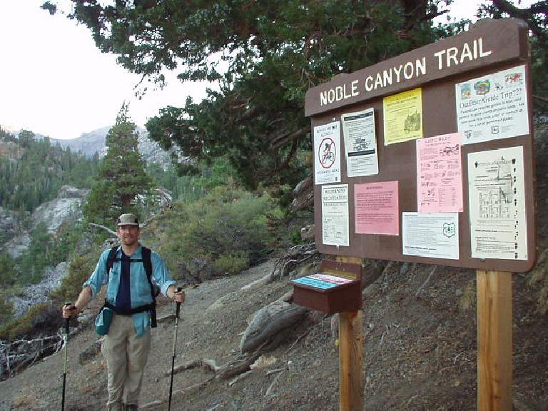 6:15pm: Just a couple of minutes from the car: Adam by the numerous warning signs posted at the trailhead of the Noble Canyon Trail.  What a day. [See Adam's pics, which actually has some shots of me!]