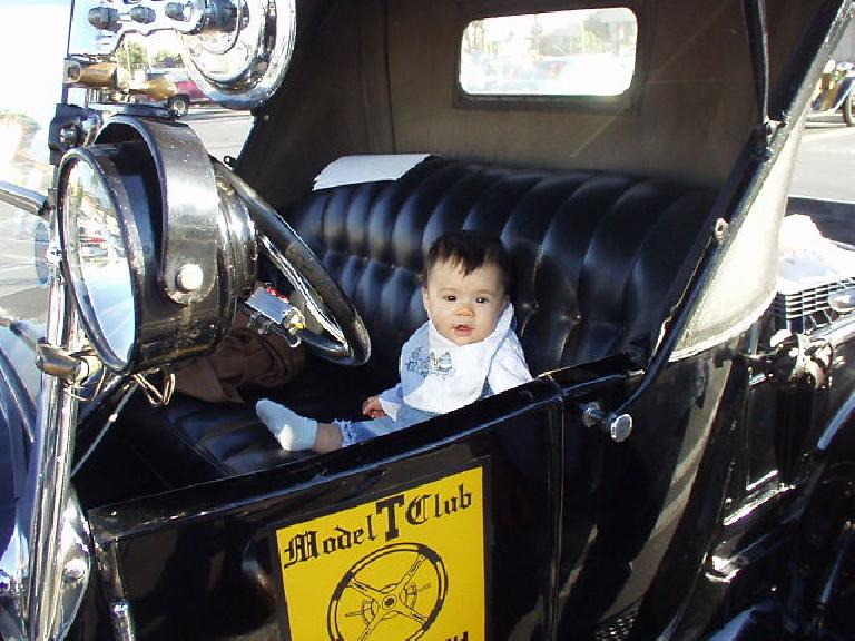 Back at the Sears/Fuddrucker's parking lot, here's little Emmalee in the driver's seat of Robert's Model T.  She's just 9 months old and already she wants to drive!