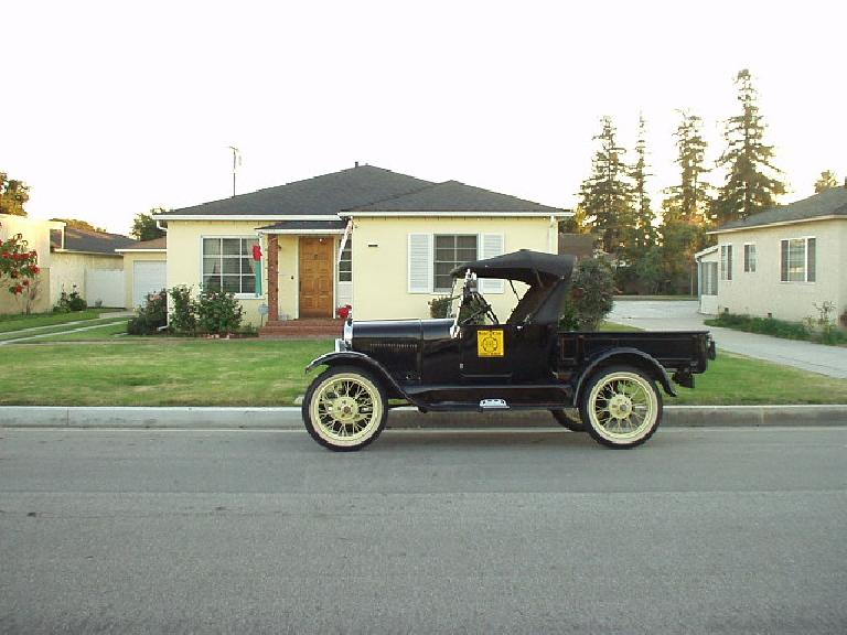 I rode with Robert in the T past 5 highways on the road back to Bellflower.  Here's the car in front of Robert's mom's home across the street; as you can see, it is in great shape!