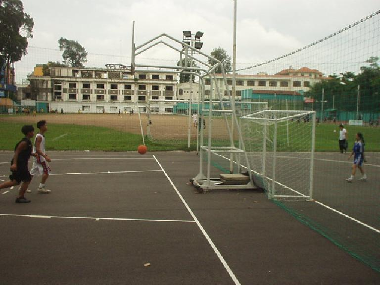 Kids were playing basketball, soccer, badmitton, and tennis in Tao Dao Park.