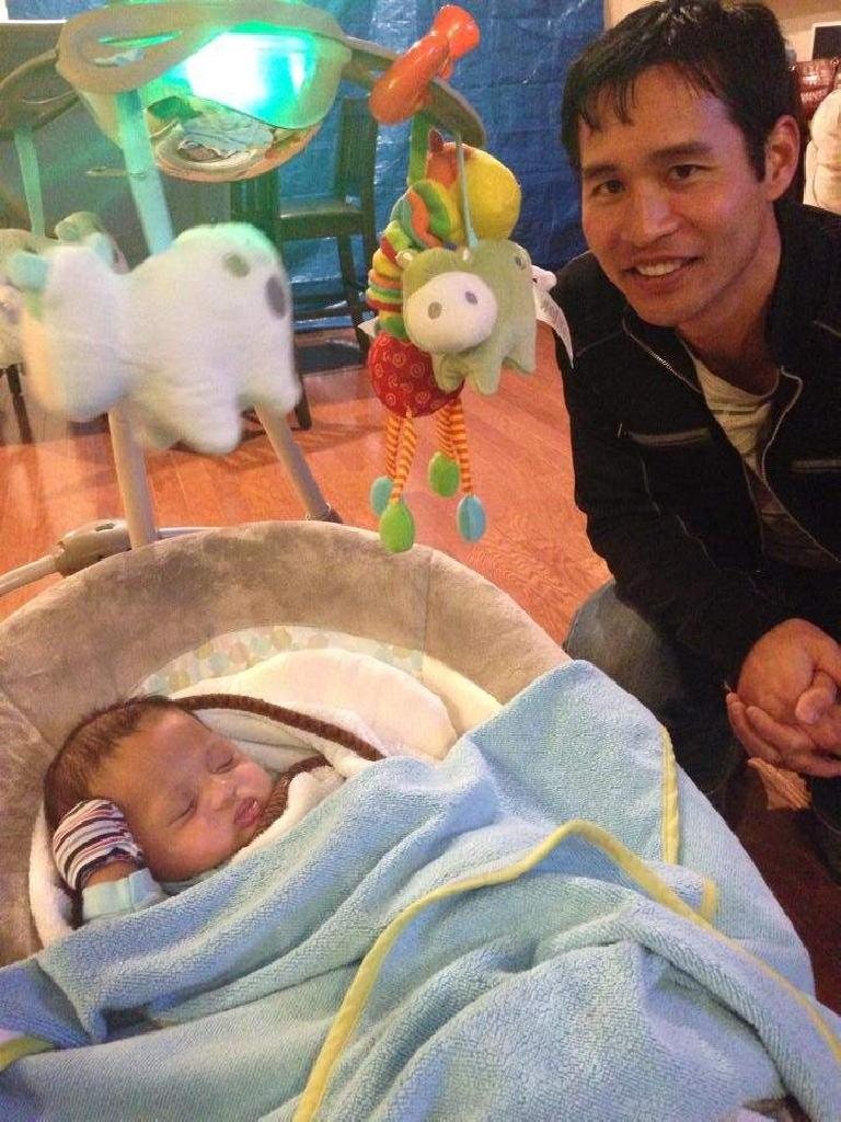 Felix Wong with Bandy's new kid. (December 24, 2014)