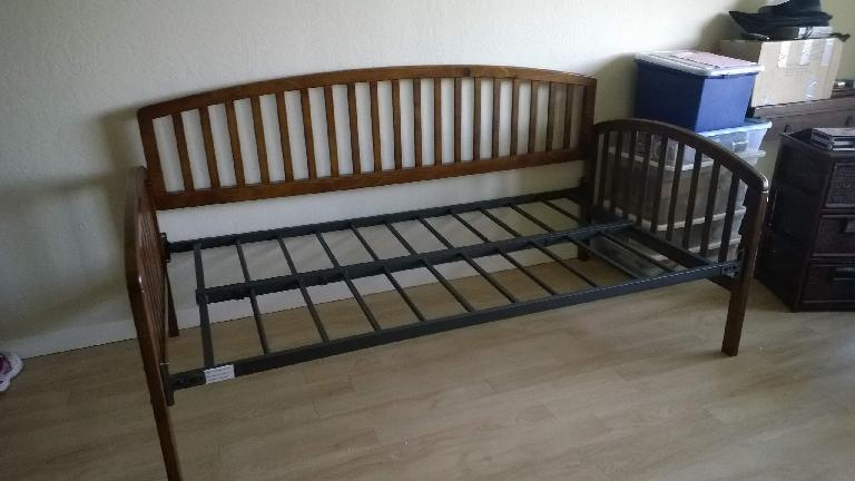 assembled bedframe with sideboard