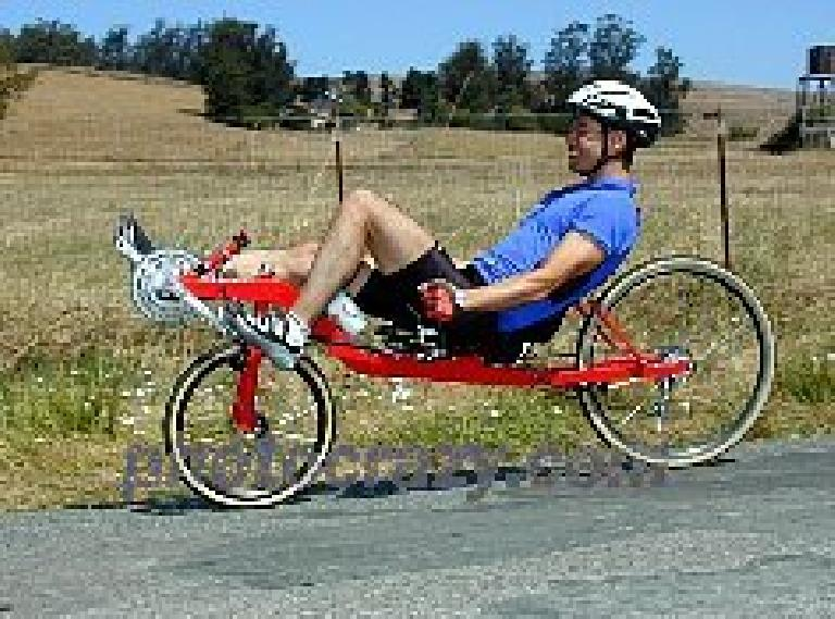 Felix Wong, blue jersey, red Reynolds Wishbone recumbent, 2001 Holstein Hundred