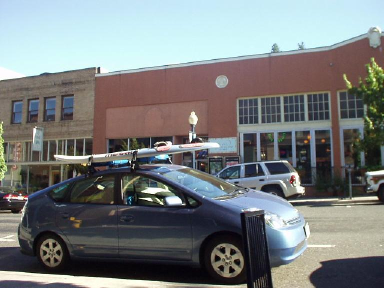 A Toyota Prius with a surfboard on top epitomizes the town pretty well!