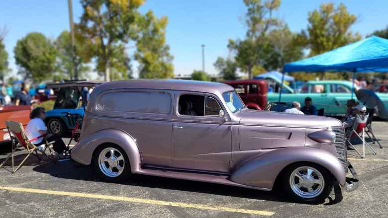 A violet hot rod panel van.