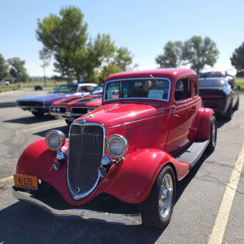 A red Ford deuce coupe hot rod.