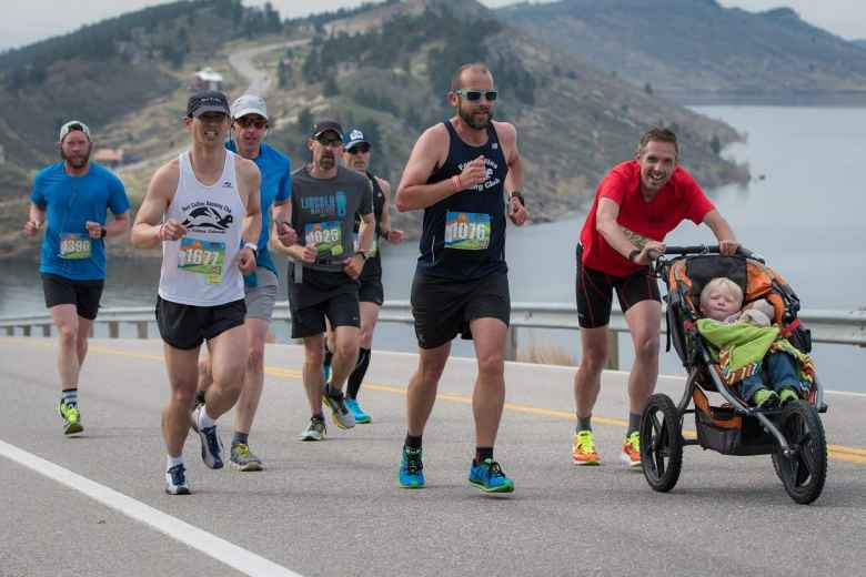 Felix Wong (white) running with Alex (black), Mike (red), and Jamo (stroller) up Monster Mountain in the 2017 Horsetooth Half Marathon.