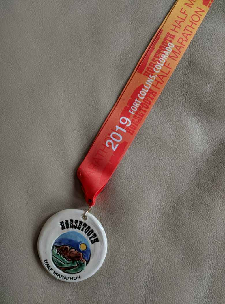 The finishing medal for the 2019 Horsetooth Half Marathon.