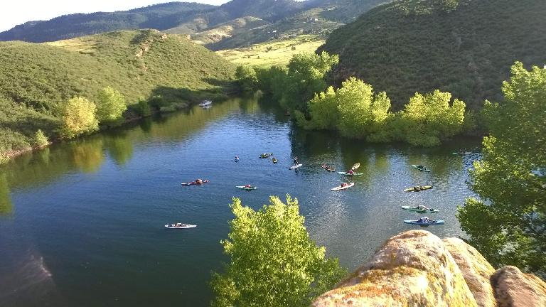 Yogis doing child pose on paddleboards at Horsetooth Reservoir.