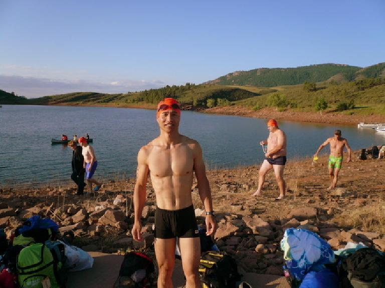 Me before jumping in the water. Clearly, because after the swim I was hypothermic and shivering so uncontrollably that the photo would have been blurry.