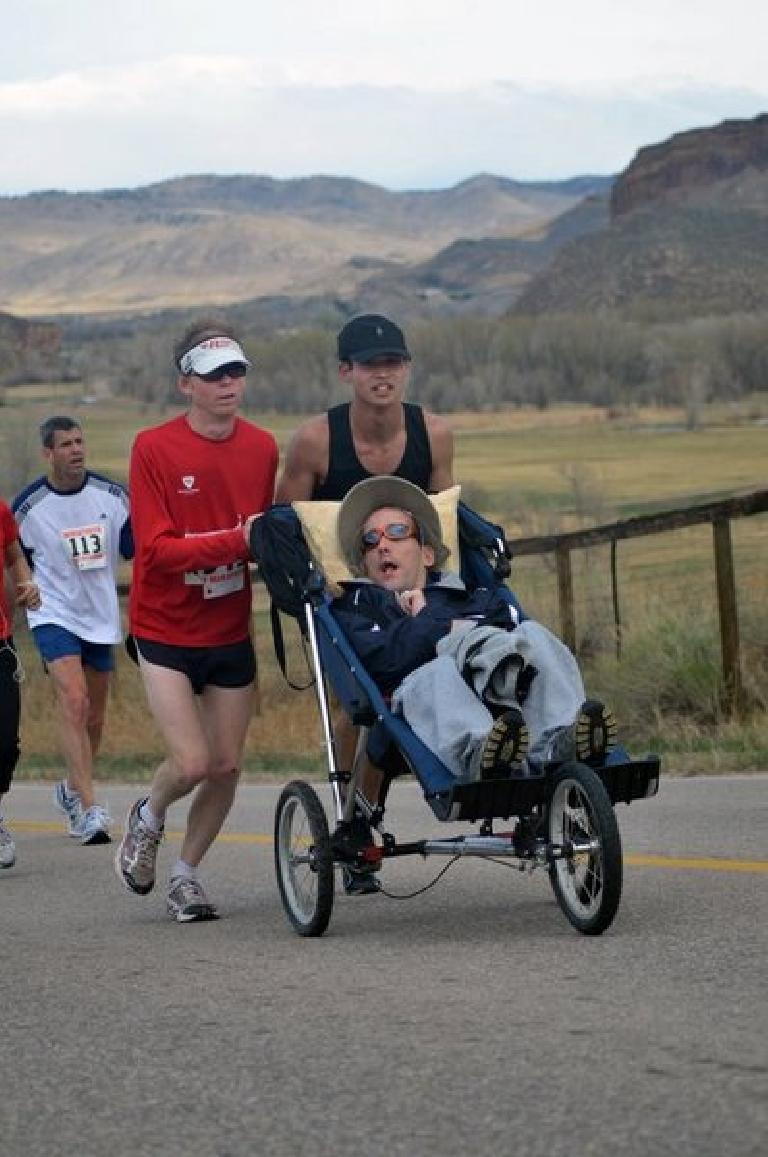 Dan J. (red), Nick (stroller) and me running up Bingham Hill in the Horsetooth Half Marathon for Athletes in Tandem. Photo: Greg Hughes.