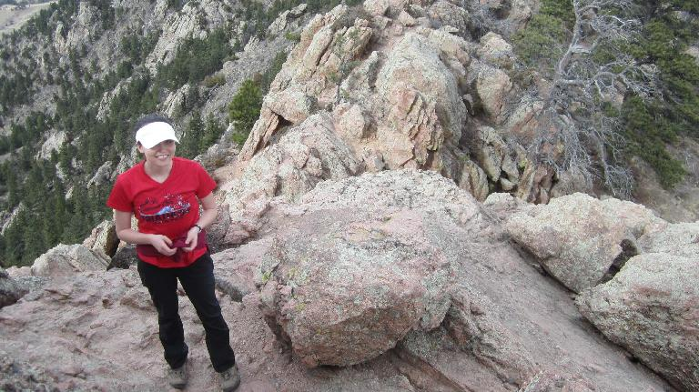 Maureen wearing red shirt on Horsetooth Rock