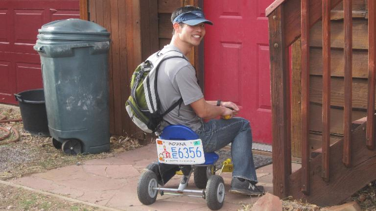 Felix Wong on a tricycle with Indiana license plates