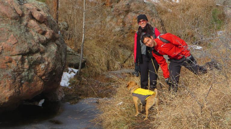 Tori, Felix Wong and Sadiq by a stream.