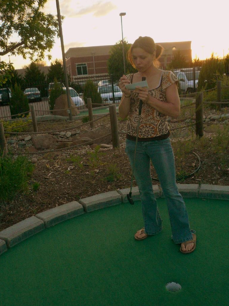 Leah tabulating how badly I beat her in mini-golf later that evening.