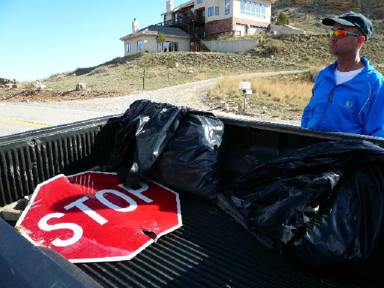 """What are you doing with this stop sign?"" I asked Chris.  Apparently, it was trash!"