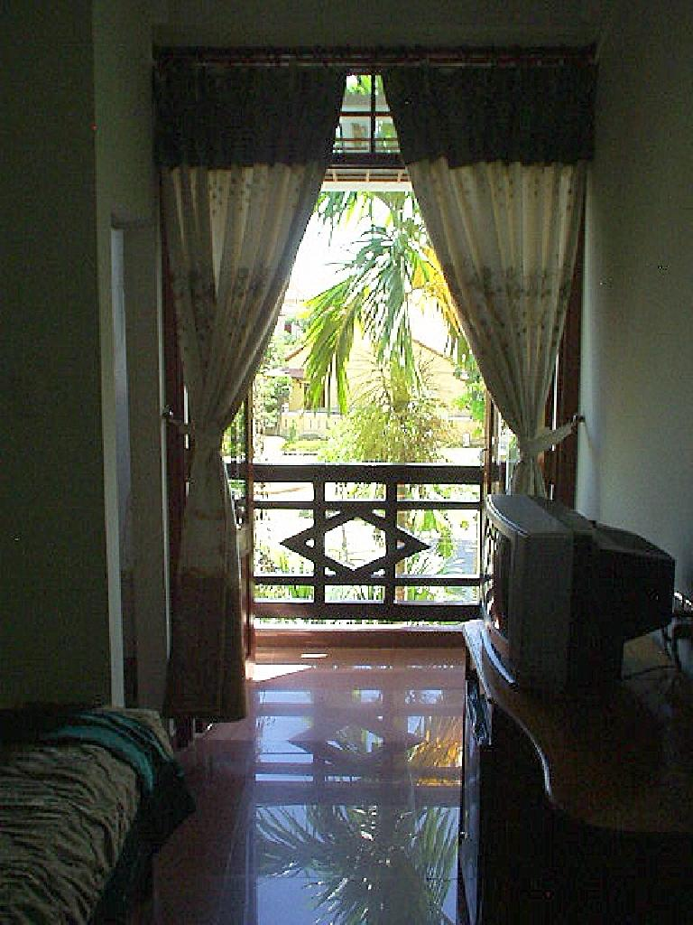 My room at the Thanh Bin III Hotel in Hoi An. (July 6, 2006)