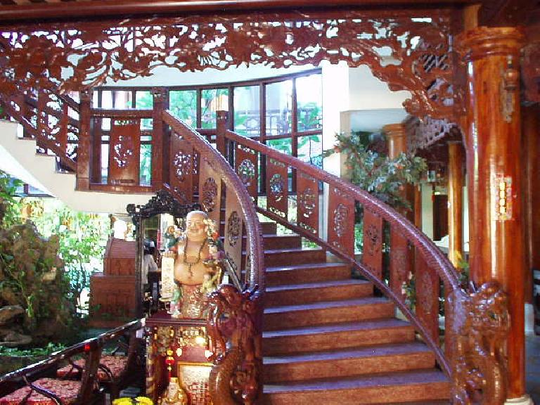 Ornate staircase at Thanh Bin III.  Not bad for a hotel where rooms cost $20ight! (July 6, 2006)