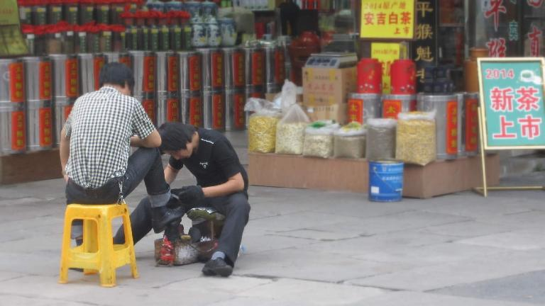 Shining shoes on Tunxi Ancient Street. (May 20, 2014)