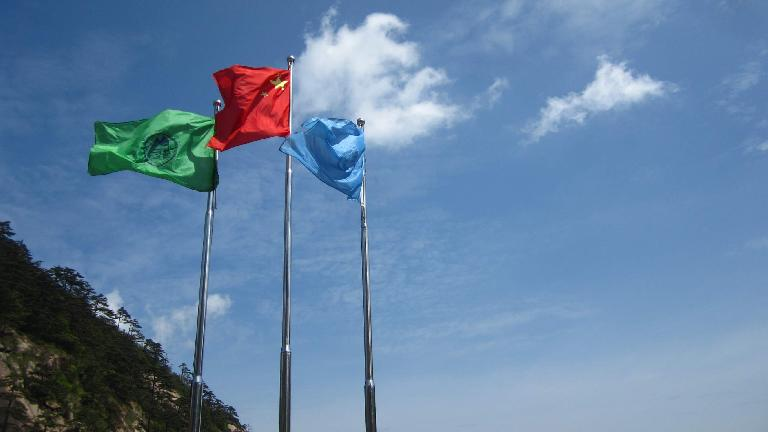 Flags flying in the Huangshan Mountains.