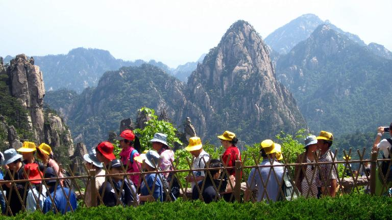 A tour group with colorful hats in the Huangshan Mountains.