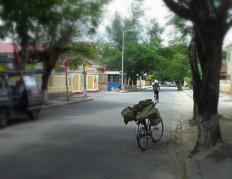 Bicycle and cyclist in Hue.