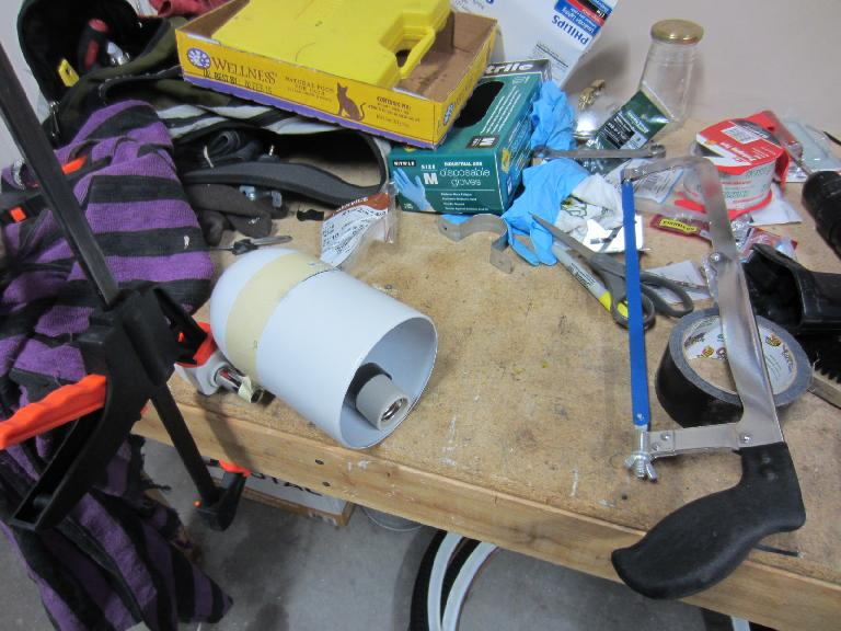 I found this outdoor light housing from Resource for $5.  First I disassembled it... (August 22, 2012)